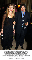 SIR TREVOR NUNN and his wife IMOGEN STUBBS, at a party in London on 10th December 2003.PPM 253