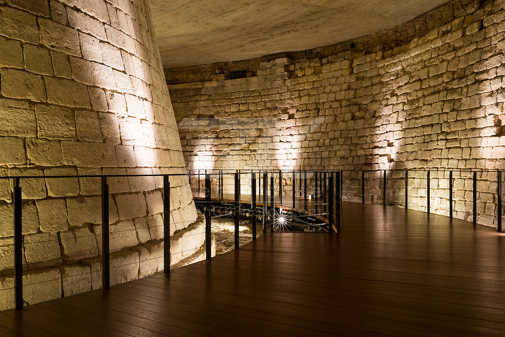 This is the moat that once surrounded the Musée du Louvre when it was a palace in Paris, France.  Visitors to the museum can now walk through it.