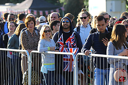 © Licensed to London News Pictures. 19/05/2018. London, UK. Royal fans board trains from Slough to Windsor for the Royal Wedding. Prince Harry is getting married to Meghan Markle today in Windsor. Photo credit: Rob Pinney/LNP