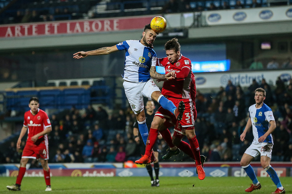 Blackburn Rovers' Derrick Williams competing with Walsall's Luke Leahy in the air<br /> <br /> Photographer Andrew Kearns/CameraSport<br /> <br /> The EFL Sky Bet League One - Blackburn Rovers v Walsall - Tuesday 30th January 2018 - Ewood Park - Blackburn<br /> <br /> World Copyright © 2018 CameraSport. All rights reserved. 43 Linden Ave. Countesthorpe. Leicester. England. LE8 5PG - Tel: +44 (0) 116 277 4147 - admin@camerasport.com - www.camerasport.com