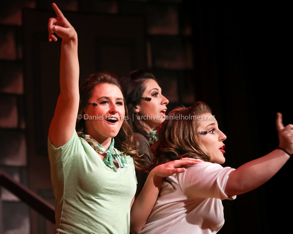 (3/17/16, HOPEDALE, MA) Street urchins from left,  Colleen Kincaid, Jen Chiarella, and Bella Baci perform during the dress rehearsal for the production of Little Shop of Horrors at Hopedale High School on Thursday. Daily News and Wicked Local Photo/Dan Holmes