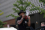 A protester uses a bull horn to lead the protesters in chants during the Teens For Peace March in Nashville, TN 2020
