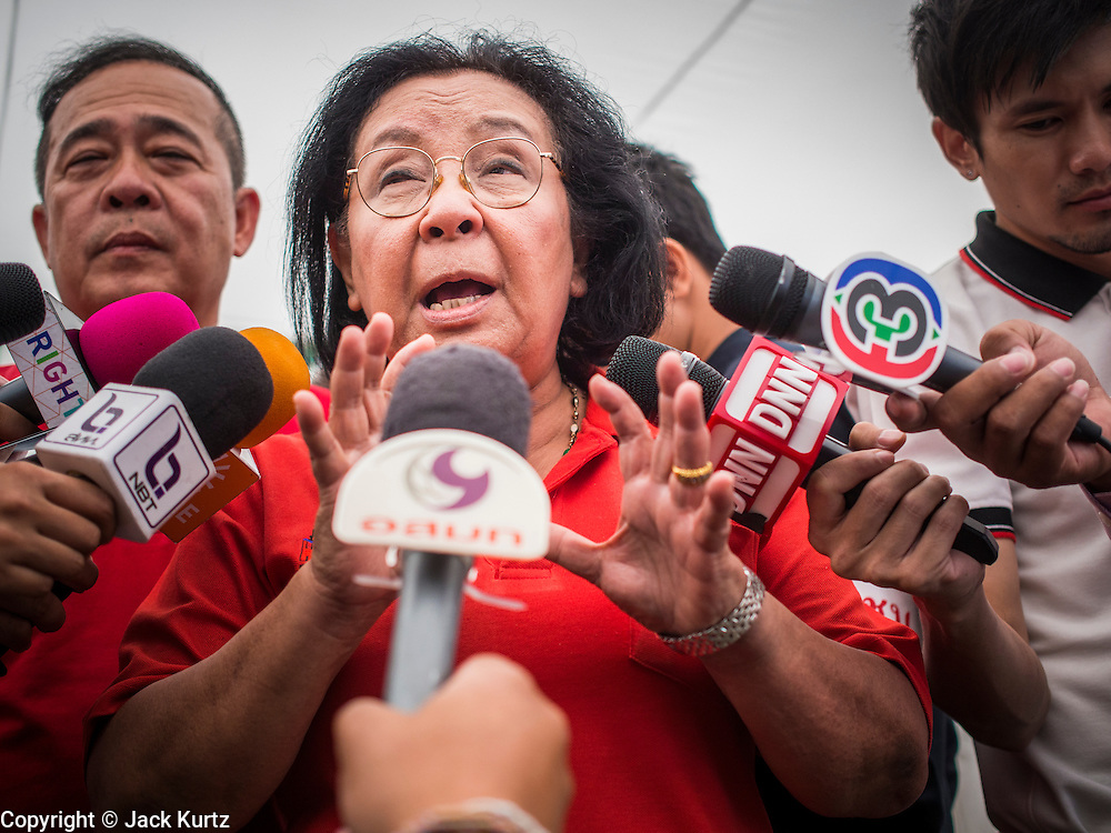 17 MAY 2014 - BANGKOK, THAILAND:  THIDA THAVORNSETH, a former chairperson of the United Front for Democracy Against Dictatorship (UDD) talks to reporters at the Red Shirts' rally in Bangkok. Thousands of Thai Red Shirts, members of the United Front for Democracy Against Dictatorship (UDD), members of the ruling Pheu Thai party and supporters of the government of ousted Prime Minister Yingluck Shinawatra are rallying on Aksa Road in the Bangkok suburbs. The government was ousted by a court ruling earlier in the week that deposed Yingluck because the judges said she acted unconstitutionally in a personnel matter early in her administration. Thailand now has no functioning government. Red Shirt leaders said at the rally Saturday that any attempt to impose an unelected government on Thailand could spark a civil war. This is the third consecutive popularly elected UDD supported government ousted by the courts in less than 10 years.   PHOTO BY JACK KURTZ