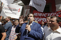 May 30, 2017 - Kiev, Ukraine - Former governor of the Ukrainian Odessa region and former Georgian president MIKHEIL SAAKASHVILI (C) speaks during a meeting of his party the ''The movement of new strengths'' in front of the Justice Ministry in Kiev, Ukraine, on 30 May 2017. Activists gathered to demand registration of MIKHEIL SAAKASHVILI political party ''The movement of new strengths'' and dismiss registration of the fake party with the same name reading like ''The block of Mikhail Saakashvili'', which was allegedly registered by Oleg Sushko, according to local media reports. (Credit Image: © Serg Glovny via ZUMA Wire)