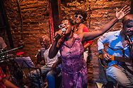 Evening of improvisational theater and music at La Aboca, run by Jota Veloso, niece of the famous Caetano