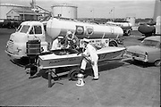 17/05/1963<br /> 05/17/1963<br /> 17 May 1963<br /> Refuelling Mr. (Joe ?) Acton's speedboat at Irish Shell installation at Alexandra Road, Dublin. Image shows the speedboat on its trailer, attached to a Ford Zodiac, alongside an Irish Shell and BP Bedford fuel truck. Boat is from Hammond's Watersports.