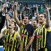 Fenerbahce's (Left to Right) Omer ONAN, Kaya PEKER, Oguz SAVAS celebrate victory during their Turkish Basketball Legague Play-Off semi final second match Efes Pilsen between Fenerbahce at the Sinan Erdem Arena in Istanbul Turkey on Friday 27 May 2011. Photo by TURKPIX