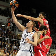 Anadolu Efes's Dusko Savanovic (L) during their Turkish Airlines Euroleague Basketball playoffs Game 4 Anadolu Efes between Olympiacos at Abdi ipekci Arena in Istanbul, Turkey, Friday, April 19, 2013. Photo by Aykut AKICI/TURKPIX