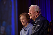 "Jimmy and Rosalynn Carter speak to a crowd of Carter Center donors at the annual ""Carter Center Weekend"" retreat at Skamania Lodge in Washington State."