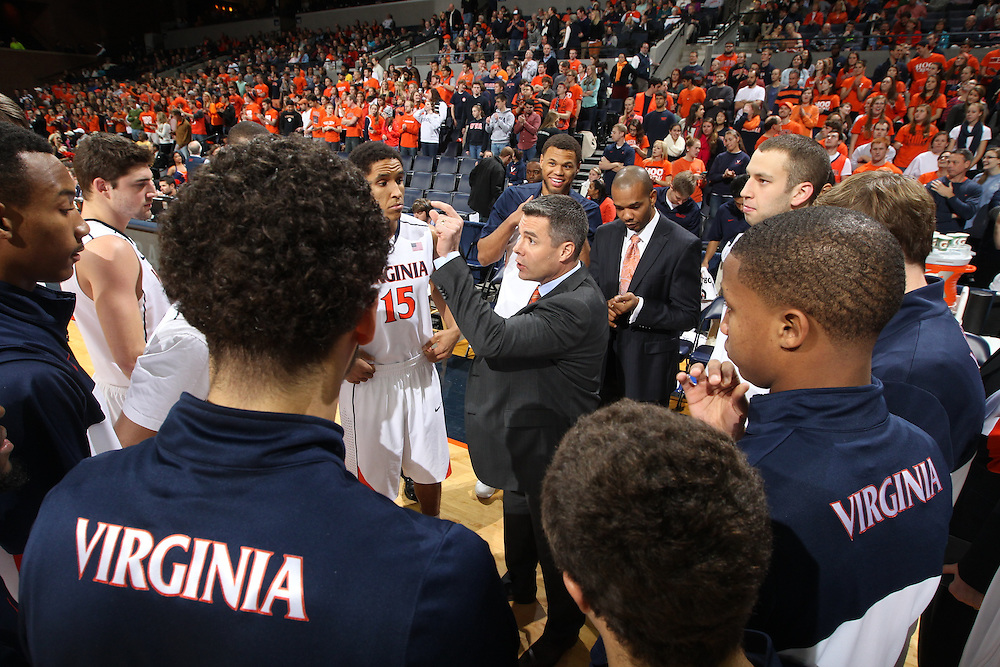 Virginia head coach Tony Bennett talks with his team during the game against Wake Forest Wednesday Jan. 08, 2014 in Charlottesville, Va. Virginia defeated Wake Forest 74-51.