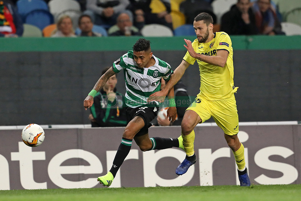 February 14, 2019 - Lisbon, Portugal - Raphinha (Raphael Dias Belloli) of Sporting CP (L) vies for the ball with Alfonso Pedraza of Villarreal FC (R) during the Europa League 2018/2019 footballl match between Sporting CP vs Villarreal FC. (Credit Image: © David Martins/SOPA Images via ZUMA Wire)