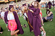 13 MAY 2009 -- TEMPE, AZ:   ASU students play on the field before their graduation ceremony Wednesday, May 13. President Barack Obama addressed the Arizona State University class of 2009 during the commencement program in Sun Devil Stadium in Tempe Wednesday evening. PHOTO BY JACK KURTZ