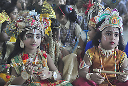 August 14, 2017 - Agartala, Tripura, India - Indian school children  dressed as Lord Krishna for a competition during Janmashtami celebration at a school in Agartala, the capital of northeastern state of Tripura. Krishna Janmashtami also known as Gokulashtami, is an annual Hindu festival that celebrates the birth of Krishna, the eighth avatar of Lord Vishnu. (Credit Image: © Abhisek Saha/Pacific Press via ZUMA Wire)