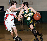 Moultonboro's Kevin Eisenberg pressures Colebrook's Ryan Call during NHIAA Class S semi final tournament game in Plymouth Thursday night.  (Karen Bobotas/for the Citizen)