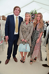 Left to right, ANNE MARIE HANSON, ANTON RUPERT and MAJA MALNAR at the Cartier Queen's Cup Polo final at Guard's Polo Club, Smiths Lawn, Windsor Great Park, Egham, Surrey on 14th June 2015