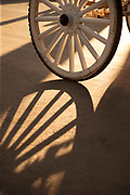 Wheel of horse-drawn carriage with shadow, Granada, Nicaragua.