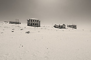 This is the deserted mining town of Kolmonskop in Western Namibia. In 1909 diamonds were found here and this industrial hamlet developed. The nearby harbour town of Lüderitz nearby also gained rapid prosperity.<br /><br />Since then however diamonds are mostly found elsewhere and so these towns went into decline. This small industrial complex is forever fighting to remain above the gale-blown desert sands but this and Lüderitz are still incredible places to visit as so little has changed at all since the early twentieth century.<br /><br />It's quite eerie standing inside the large derelict buildings, the winds literally howling through the broken windows and doors and dunes almost visibly being created in front of your eyes.