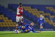 AFC Wimbledon attacker Adam Roscrow (10) performing a sliding tackle during the EFL Trophy match between AFC Wimbledon and U21 Arsenal at Plough Lane, London, United Kingdom on 8 December 2020.