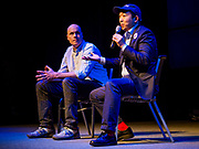 28 APRIL 2019 - DES MOINES, IOWA: J.D. SCHOLTEN, left, an Iowa Democrat, sits on stage with ANDREW YANG while Yang answers questions during a Town Hall event in Des Moines. Yang, an entrepreneur, is one of 20 Democrats running for the Democratic nomination for the US Presidency in 2020. Iowa hosts the the first election event of the presidential election cycle. The Iowa Caucuses will be on Feb. 3, 2020.                 PHOTO BY JACK KURTZ