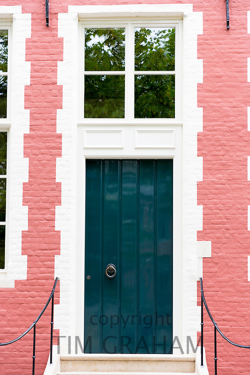 Traditional bright colour painted door, doorway and brickwork stylish renovation in old town Bruges - Brugge - Belgium
