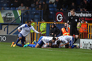 Hallam Hope of Bury (on ground c) celebrates with his teammates after scoring his teams 4th goal. EFL Skybet football league one match, Bury v Port Vale at Gigg Lane in Bury ,Lancs on Saturday 3rd September 2016.<br /> pic by Chris Stading, Andrew Orchard sports photography.