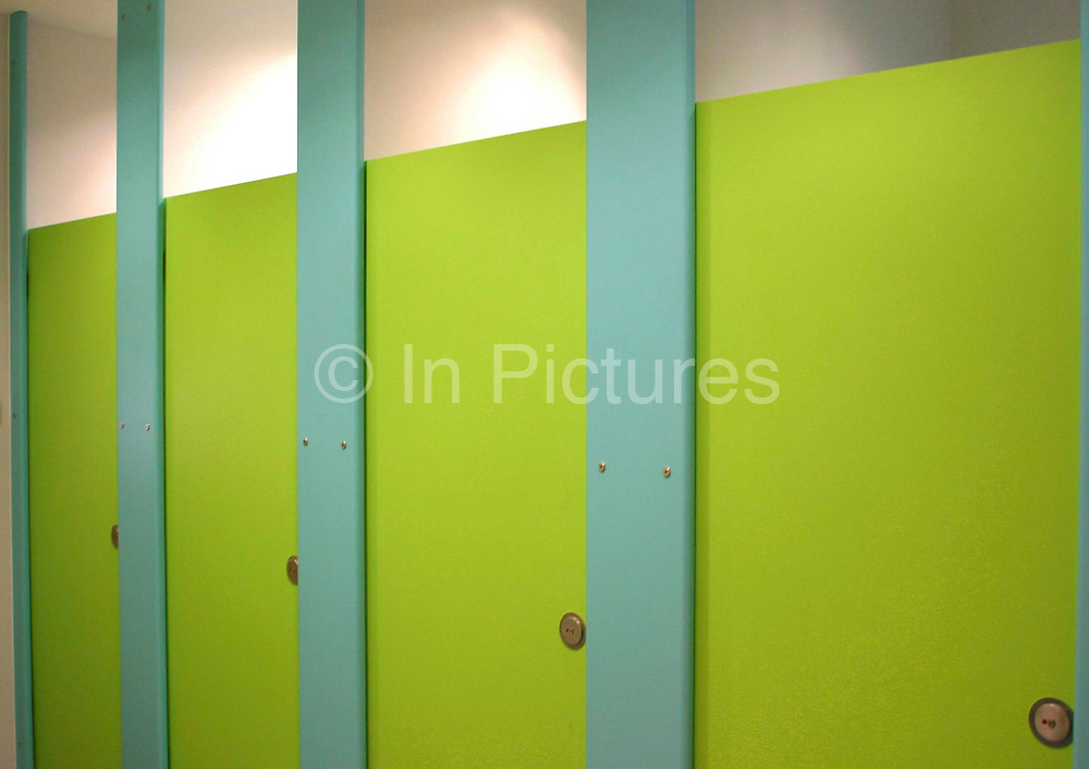 Toilet cubicles inside the new East London Childcare Institute building.