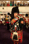 PIPES AND DRUMS 1ST BATALION, THE SCOTS GUARDS, , The Royal Caledonian Ball 2011. In aid of the Royal Caledonian Ball Trust. Grosvenor House. London. W1. 13 May 2011.<br /> <br />  , -DO NOT ARCHIVE-© Copyright Photograph by Dafydd Jones. 248 Clapham Rd. London SW9 0PZ. Tel 0207 820 0771. www.dafjones.com.