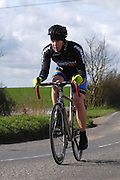United Kingdom, Finchingfield, Mar 27, 2010: Will Oinn, London Dynamo, approaches the 4 miles to go marker during the 2010 edition of the 'Jim Perrin' Memorial Hardriders 25.5 mile Sporting TT promoted by Chelmer Cycling Club. Copyright 2010 Peter Horrell.