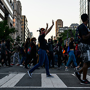 Black Lives Matter protesters march towards the capitol after gathering at Lafayette park to defy the curfew and protest the killing of George Floyd in Minneapolis.