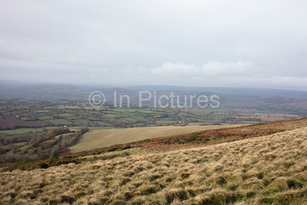 Landscape view looking from Brown Clee Hill out over the Shropshire Hills, a designated Area of Outstanding Natural Beauty on 13th November 2019 near Burwarton, Shropshire, United Kingdom. The Shropshire Hills, located in the Welsh Marches, are relatively high: the highest point in the county, Brown Clee Hill, near Ludlow, has an altitude of 540 metres.