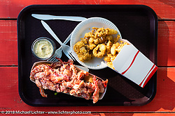 Yummy lobster roll and fried clams at the Tamarack Drive-In window serve restaurant during Laconia Motorcycle Week. NH, USA. Friday, June 15, 2018. Photography ©2018 Michael Lichter.