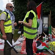 Resist DSEI: Stop Arming Israel Demonstration march in East London shouting Stop arming Israel on 2021-09-12, London, UK.