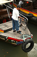 """Bumboat Captain - A bumboat is a small boat used to ferry supplies to ships moored away from the shore.  Originally referring to a scavenger's boat, <br /> In Singapore the term """"bumboat"""" is applied to small boats used to take tourists on tours."""