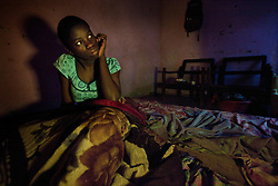 Phiona Mutesi, a 14-year-old chess prodigy, at home inside Katwe, the largest slum in Kampala, Uganda, Dec. 10, 2010. Mutesi lives in the slums of Uganda and is just now learning to read. When she was just nine she had already dropped out of school because her family couldn't afford it. But her instincts have made her a player to watch in international chess. Mutesi, a naturally talented chess player is coached by Robert Katende of Sports Outreach Ministry. The chess club meets at the Agape Church.