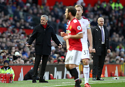 Manchester United manager Jose Mourinho (left) looks puzzled on the touchline during the Premier League match at Old Trafford, Manchester.