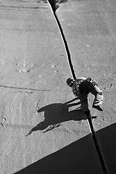 Mike Wheat climbing Supercrack 5.10. Indian Creek, UT