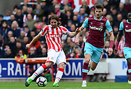 Joe Allen of Stoke takes a shot on goal . Premier league match, Stoke City v West Ham Utd at the Bet365 Stadium in Stoke on Trent, Staffs on Saturday 29th April 2017.<br /> pic by Bradley Collyer, Andrew Orchard sports photography.