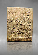 Hittite sculpted orthostats panels of Long Wall Limestone, Karkamıs, (Kargamıs), Carchemish (Karkemish), 900-700 B.C. Soldiers. Anatolian Civilisations Museum, Ankara, Turkey<br /> <br /> Figure of two helmeted warriors. They have their shield in their back and their spear in their hand. The prisoner in their front is depicted as small. The lower part of the orthostat is decorated with braiding motifs. <br /> <br /> On a grey art background. .<br />  <br /> If you prefer to buy from our ALAMY STOCK LIBRARY page at https://www.alamy.com/portfolio/paul-williams-funkystock/hittite-art-antiquities.html  - Type  Karkamıs in LOWER SEARCH WITHIN GALLERY box. Refine search by adding background colour, place, museum etc.<br /> <br /> Visit our HITTITE PHOTO COLLECTIONS for more photos to download or buy as wall art prints https://funkystock.photoshelter.com/gallery-collection/The-Hittites-Art-Artefacts-Antiquities-Historic-Sites-Pictures-Images-of/C0000NUBSMhSc3Oo