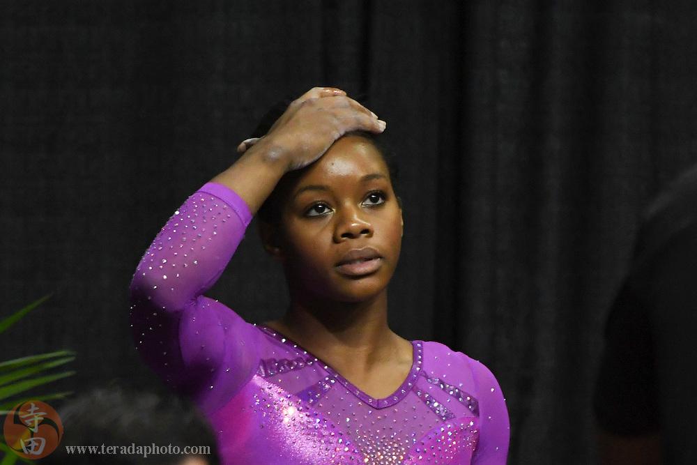 July 8, 2016; San Jose, CA, USA; Gabby Douglas, from Tarzana, CA, reacts after the balance beam in the women's gymnastics U.S. Olympic team trials at SAP Center.