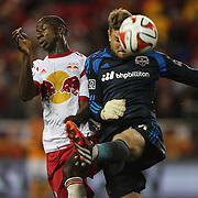 Goalkeeper Tyler Deric, Houston Dynamo, clears while challenged by Bradley Wright-Phillips, New York Red Bulls, during the New York Red Bulls Vs Houston Dynamo, Major League Soccer regular season match at Red Bull Arena, Harrison, New Jersey. USA. 4th October 2014. Photo Tim Clayton