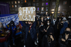 © Licensed to London News Pictures. 05/11/2020. Manchester, UK. Protesters hold a minute's silence in memory of Finn Kitson , who died at the University . It's reported he was suffering severe anxiety during the university's lockdown . Hundreds of students protest and march through the campus , tearing down fences where The University of Manchester have erected fencing around student accommodation blocks , at the Owens Park campus of the UoM , on the first day of a national coronavirus lockdown in England . Students living at halls of residence on the site say no notification was given ahead of the erection of fences , which the university claims are for students' security. Photo credit: Joel Goodman/LNP