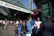 Borough Market reopens to the public after being closed in London, England, United Kingdom. Everything was back to normal with people and workers around the London Bridge area, hanging out after work at the Market Porter pub which was closed following the London Bridge terror attack. Friends hang out as normal for drinks on a Summer evening.