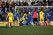 Scramble in the box before Fleetwood Town attacker Ched Evans (9) scores goal during the EFL Sky Bet League 1 match between AFC Wimbledon and Fleetwood Town at the Cherry Red Records Stadium, Kingston, England on 8 February 2020.