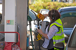 © Licensed to London News Pictures 27/09/2021.<br /> Swanley, UK, A member of staff putting out of use signs on the diesel pumps. Chaos at this Co-op petrol station in Swanley, Kent. This station had a delivery at 7.30 am this morning and at 2.30pm started to run out of diesel. Fuel panic buying continues today on forecourts up and down the UK as hoarders run petrol stations dry. Photo credit:Grant Falvey/LNP