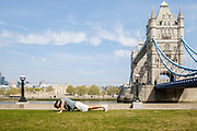 Man exercising, with Tower Bridge in the background while London is on lockdown as a result of the Coronavirus Pandemic on 16th April 2020 in London, United Kingdom. Coronavirus or Covid-19 is a new respiratory illness that has not previously been seen in humans. Much of Europe has been placed into lockdown, with stringent rules in place as part of a long term strategy, and in particular social distancing, and a stay at home policy.