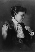African American woman, half-length portrait, seated. photographic print gelatin silver.[1899 or 1900]