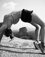 Hanna Hankel, enjoying a several-week break from university studies in Germany, does a back bend atop Pidurangala Rock in Sri Lanka. Behind her is one of the country's landmarks, Sigiriya Rock.