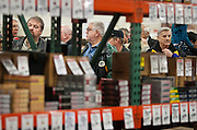 Visitors look on while waiting in the ammunition line at the South Towne Expo Center during the 2013 Rocky Mountain Gun Show, Saturday, Jan. 5, 2013.