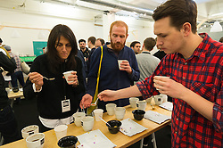 © Licensed to London News Pictures. 07/04/2016. Visitors coffee cupping at The London Coffee Festival. Now its 4th year, will attract over 35,00 visitors over the four day event. London, UK. Photo credit: Ray Tang/LNP