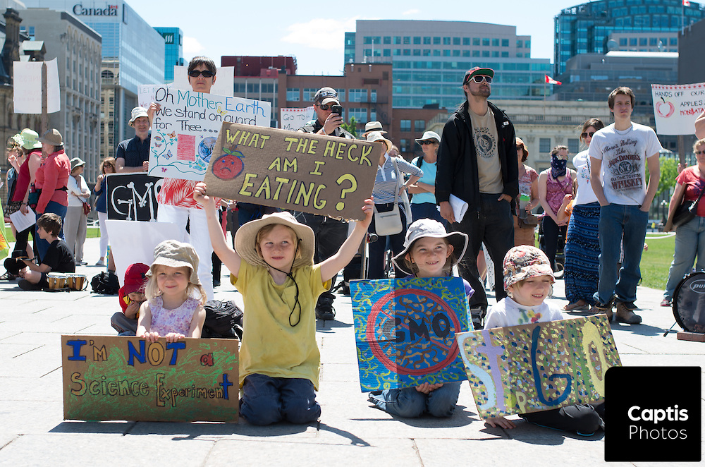 A group of children hold signs at a protest against Monsanto. May 31, 2014.